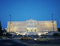 Greek Parliament in Athens, Syntagma Square. In the center of Greece lies a true masterpiece and the cause of the curse for our country Stock Photo
