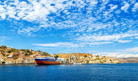 Greek passenger sea ferry of Dodekanisos regular maritime traffic in bay of Simi island at background of hills and blue Royalty Free Stock Photography