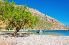 Greek pebble beach in quiet bay, Aegean Sea Greece Royalty Free Stock Images
