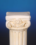 Greek pedestal on a blue background Stock Image