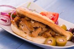 Greek pita bread. Greek pita bread with salad on white dish royalty free stock photos