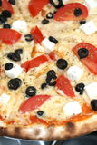 Greek pizza. Feta cheese and olives pizza Stock Photo