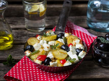 Greek potatoes skillet with feta cheese, olives and pepper Stock Photography