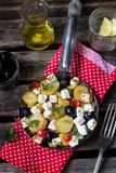 Greek potatoes skillet with feta cheese, olives and pepper Royalty Free Stock Photos
