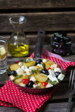 Greek potatoes skillet with feta cheese, olives and pepper Stock Image