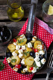 Greek potatoes skillet with feta cheese, olives and pepper Royalty Free Stock Photography