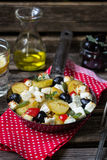 Greek potatoes skillet with feta cheese, olives and pepper Royalty Free Stock Image