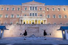 Greek presidential guard, Evzones, parading in front of the Greek parliament on Syntagma square. Picture of Evzones the elite presidential guard walking in stock photography