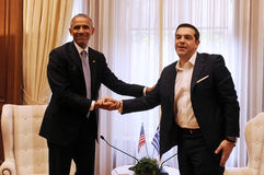 Greek Prime Minister Alexis Tsipras, right, speaks with U.S. Pre Royalty Free Stock Photography