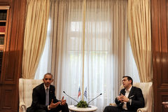 Greek Prime Minister Alexis Tsipras, right, speaks with U.S. Pre Royalty Free Stock Photos