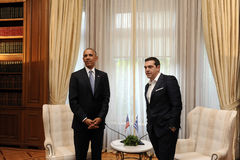 Greek Prime Minister Alexis Tsipras, right, speaks with U.S. Pre Royalty Free Stock Images