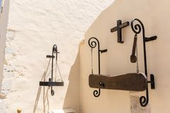 Greek religious symbol,cross,plaque with name on wall of  monastery in Crete, Greece Stock Images
