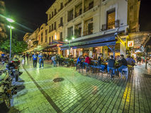 Greek restaurant and bar exterior. Serving clients in the evening Stock Photo