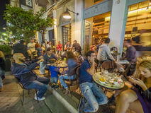 Greek restaurant and bar exterior. Serving clients in the evening Royalty Free Stock Photos