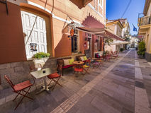 Greek restaurant in shaded alley Stock Image