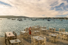 Greek restaurants and taverns are ready to welcome tourists at Alyki village in Paros island. Royalty Free Stock Image