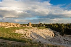 Greek Roman Theater in Syracuse - Sicily Italy. Ancient Greek Roman theater at sunset in Syracuse city Siracusa, Sicily island, Italy V century BC Stock Photos