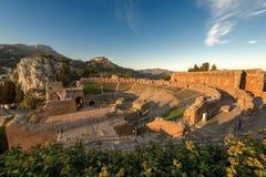 Greek Roman Theater in Taormina - Sicily Italy. Ancient Greek Roman theater at sunset in Taormina town, Messina, Sicily island, Italy II century AD Stock Photography