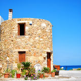 Greek round house. A round shaped house situated on the Greek isle of crete Stock Images