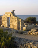 Greek ruines near the sea. stock illustration