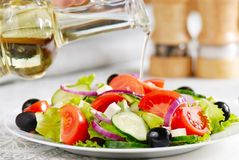 Greek salad. In the white plate closeup shot Royalty Free Stock Photos