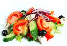 Greek salad. A delicious Greek salad. Bright, tasty and healthy royalty free stock image