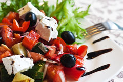 Greek salad. Greek Mediterranean salad with feta cheese, olives and peppers Stock Photos