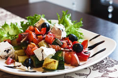 Greek salad. Greek Mediterranean salad with feta cheese, olives and peppers Royalty Free Stock Photo