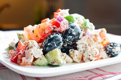 Greek Salad. On a waffle napkin close up Royalty Free Stock Images