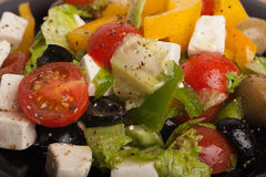 Greek salad. Fresh and juicy Greek salad closeup Stock Images