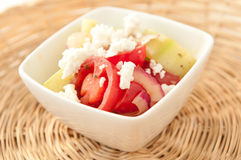 Greek salad. Tomato, cucumber and feta salad with olive oil and lemon, this greek salad is a healthy meal choice Stock Photography