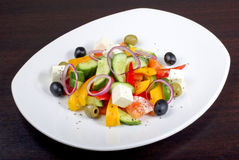 Greek salad. With vegetables on dark table Stock Photo