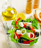 Greek salad. Greek vegetable salad with feta cheese, top view Royalty Free Stock Images