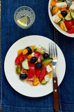 Greek salad. With feta cheese, olives and vegetables Royalty Free Stock Photo