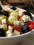 Greek salad. Bowl of salad with cheese and olives royalty free stock photos