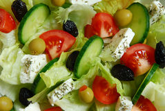Greek salad. Traditional and healthy greek salad with green and black olives, feta cheese, tomatoes, cucumber and olive oil Royalty Free Stock Image