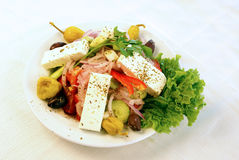 Greek salad. A plate with greek salad and fresh vegetables royalty free stock image