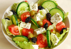 Greek salad. Fresh greek salad in a bowl royalty free stock photos