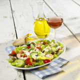 Greek salad. Bread, olive oil and glass of wine Stock Photo
