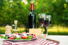 Greek Salad And Glass Of Wine Royalty Free Stock Photo