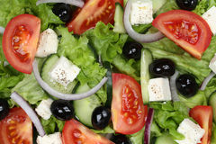 Greek salad background with tomatoes, Feta cheese and olives Stock Image