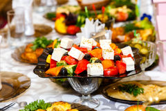 Greek salad on banquet table Stock Images
