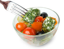 Greek salad in bowl and fork Stock Image