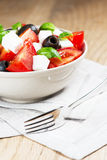 Greek salad in bowl half Stock Photography