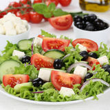 Greek salad in bowl with ingredients like tomatoes, Feta cheese Stock Photography