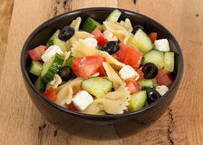 Greek salad bowl with pasta Royalty Free Stock Photo