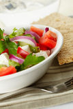 Greek salad with bread. Close up view Royalty Free Stock Photos