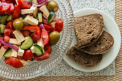Greek salad with bread slices Stock Photography