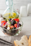 Greek salad  with bread on the white scratched table Royalty Free Stock Photography
