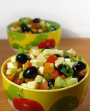 Greek salad in a bright plate Royalty Free Stock Images